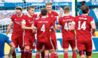Aberdeen's Sam Cosgrove (centre) celebrates making it 2-0 against Kilmarnock with his team-mates.