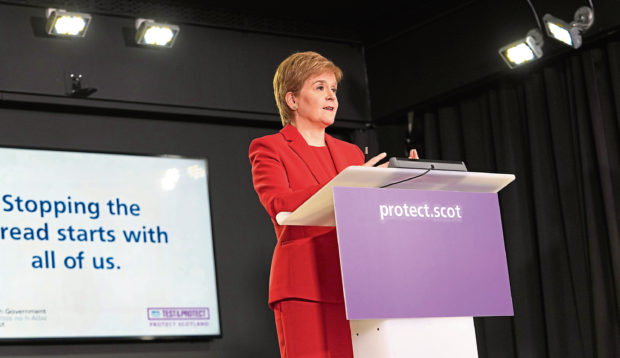 Frank Gilfeather: Don't fret, Nicola's on the case at her Covid lectern