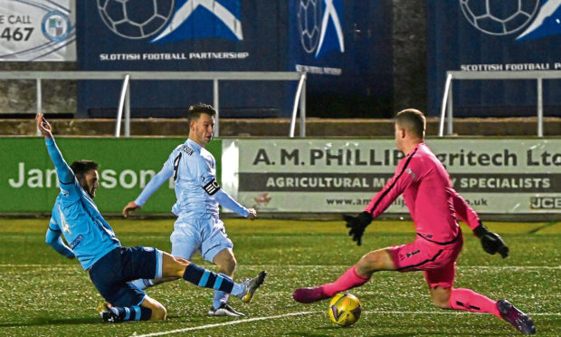 CR0025975 Scottish League One - Forfar Athletic (blue) v Cove Rangers (white), at Station Park, Forfar. Picture of Mitch Megginson scoring.  Picture by Kenny Elrick     26/12/2020