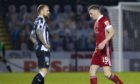 Aberdeen's Lewis Ferguson heads to the dressing room after receiving a red card during the Scottish Premiership match between St Mirren and Aberdeen.