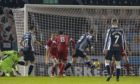 St Mirren's Lee Erwin misses a chance late in the Premiership match between St Mirren and Aberdeen. Andy Considine was able to block on the line.