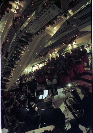 1995: Shoppers get in tune with the festive season at Aberdeen's Bon Accord Centre yesterday during a Christmas carol concert. The mood music was provided by barbershop singing aces the Sweet Adelines, the Salvation Army and St Joseph's school choir.
