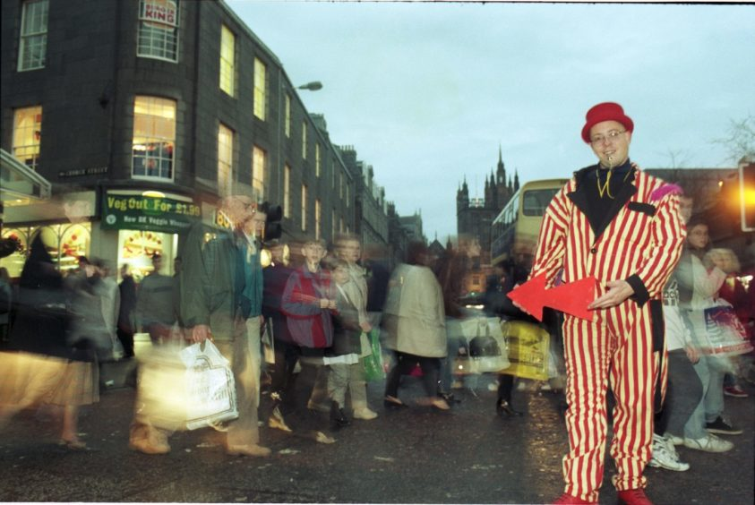 1996: Street entertainer Sean Burn, from Maverick Productions, entertains the shoppers in Aberdeen yesterday.