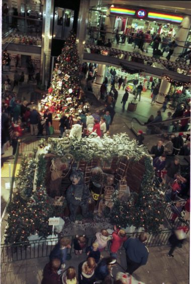 1996: Christmas decorations and Christmas trees to cheer up shoppers.