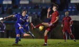 Peterhead captain Scott Brown, left, scoring against East Fife earlier this season.