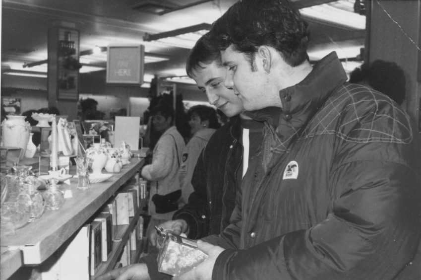 1991: Unlikely lads: offshore worker Kevin Stewart, (left), has made a Christmas shopping list this year. Salesman Steve Ross-Munro, (right), can't be bothered with Christmas this year.