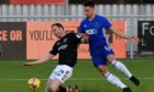 Cove Rangers forward Leighton McIntosh goes up against Sean Dillon of Montrose.