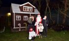 Pictured are from left, Kerry Ronald, Nevaeh Ronald, Santa and Cally Bowman. A family have converted a playhouse into their very own Santa's grotto near Portlethen.  Picture by Darrell Benns.