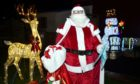Pictured is Santa at a grotto set up by Payton Crookbain and her family on Beech Road, Northfield, Aberdeen. They are handing out presents to children everyday until Christmas. Pictured by Darrell Benns Pictured on 18/12/2020 CR0025902