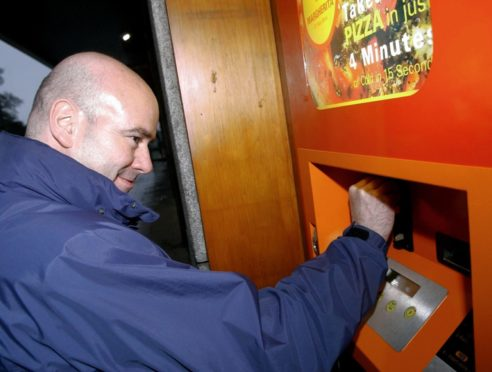 Scott Begbie at the pizza vending machine in 2004.