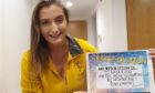 Archie's community fundraising officer Emily Findlay with her target for 2021.