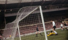 Denis Law scores for Scotland against England at Wembley in the famous 3-2 win.