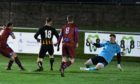 Keith's Michael Selfridge beats Huntly's keeper Euan Storier in the Evening Express Aberdeenshire Cup. Picture by Chris Sumner