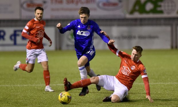 Blair Yule in action for Cove Rangers against Clyde.