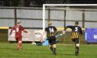 Dane Ballard, left, has his penalty saved by Huntly goalkeeper Euan Storrier