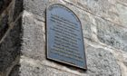 The information plaque about ties to slavery on Aberdeen's Sugarhouse Lane.