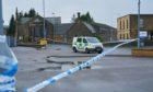 Police sealed off a car park in Elgin.