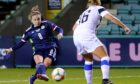 Scotland's Kim Little (left) has a shot on goal.