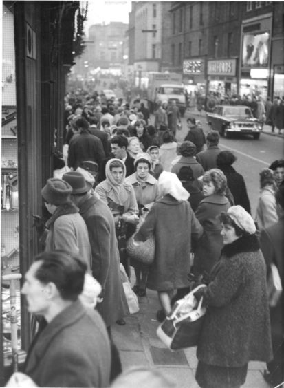 1962: Housewives should be awarded the budget-beaters' medal - they are always on the alert for the best buy and usually achieve wonders. This is a scene in George Street, Aberdeen.