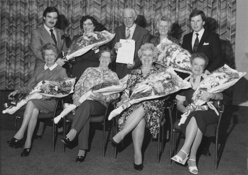 It was retiral night at the Treetops Crest Hotel when seven of the employees retired. There to present the gifts were (right, back row) general manager Gair Stott and (left, back row) deputy manager Kevin Gilling. Retiring were (back row, left to right) function waitress Mrs Peggy Shepherd (eight years), cellarman Robert Pirie (eight years) and Mrs Jean Weatherly, waitress (five years). Front (left to right) function waitress Mrs Ethel Collins (13 years), kitchen maid Mrs Elizabeth Cooper (three years), Mrs Evelyn Hamill, canteen supervisor (six years) and still room maid Mrs Betty Watt (10 years).