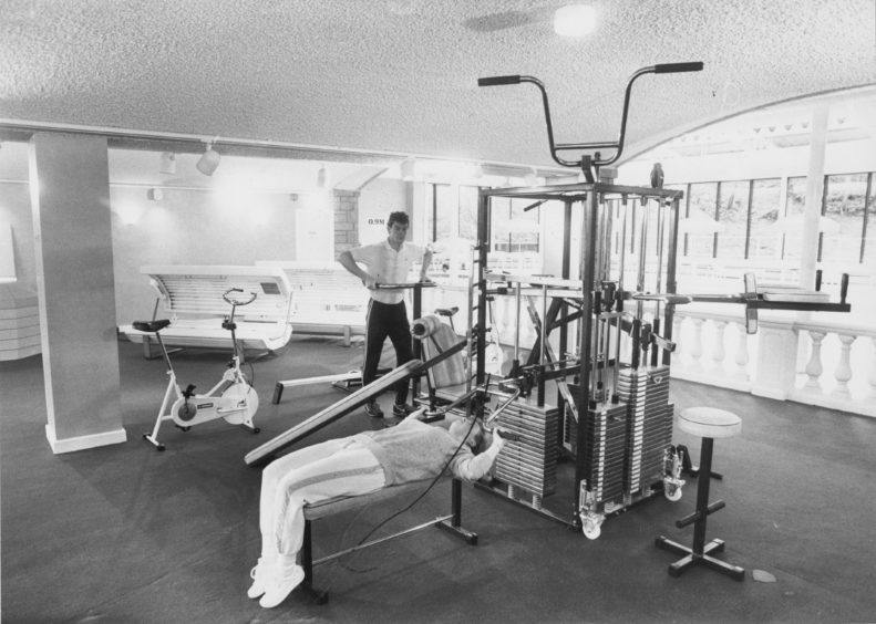 Pool attendant Lynne Ewen and Leisure Club Manager Bob Diack test the equipment in the new multi-gym at the Tree Tops Hotel, Aberdeen.