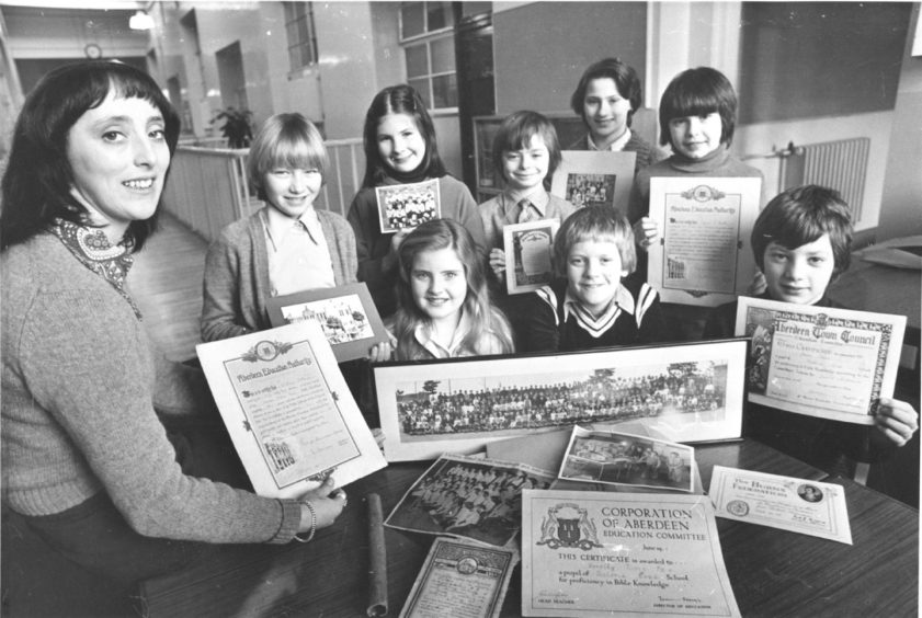 1978:  Primary 7 pupils at Victoria Road School and their teacher Mrs Mary Mitchell sort out photographs and certificates sent in by former pupils.