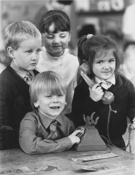 1987: It's for you primary one pupil at Torry's Victoria Road Primary School, Claire Cowe puts a call through to her mum with some dialling help from Martin Douglas (centre) while Stuart McKenzie and Sarah Walker hang on.
