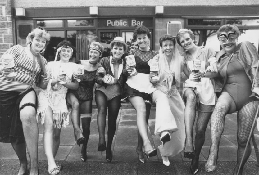 1988: Shaking a leg, and a collecting tin, during a marathon fancy dress pub crawl collection on Saturday are eight mothers of pupils at Victoria Road Primary in Torry.