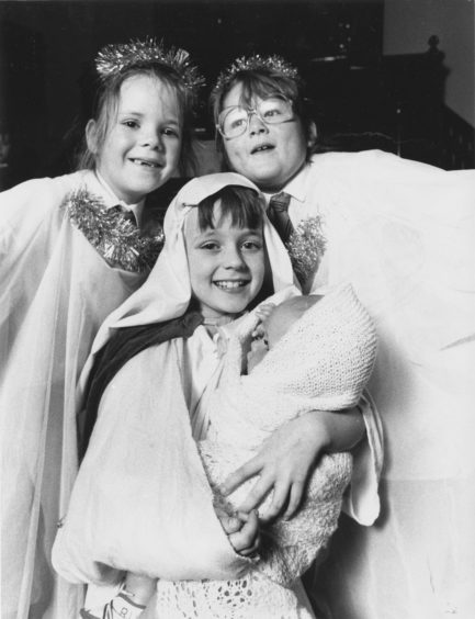 1989: Pamela (centre) looks angelic between angels Carinne Shirran (right) and Jennifer Clyne, both aged seven.