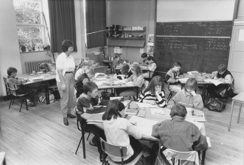 1990: Victoria Road Primary School class 7 teacher, Mrs Smith, watches her young consumers and possible advertising campaigners of the future.