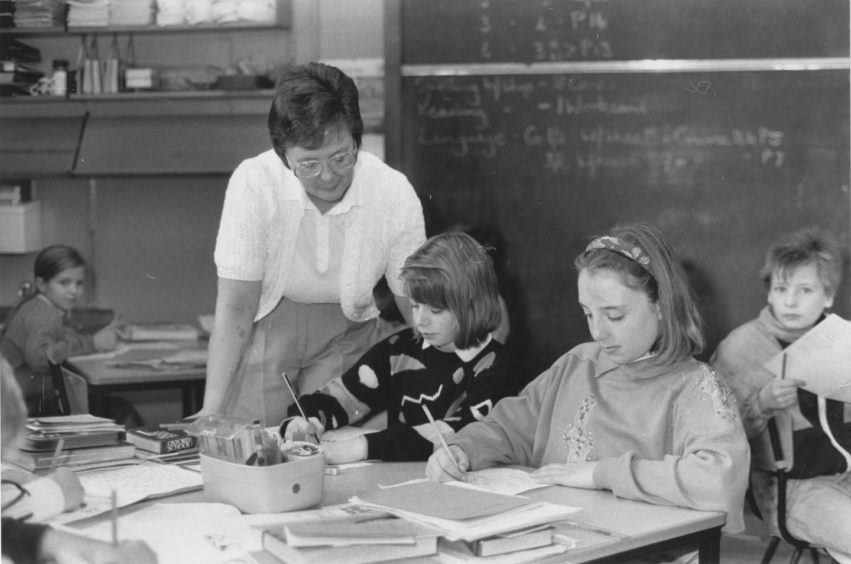1990: Mrs Smith with (left), Laura Summers and (right), Jenna Pirie, as they draw their advert ideas