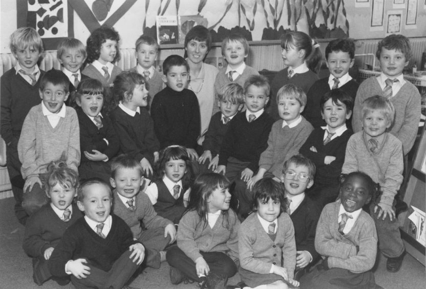1992: Look this way: Mrs Liz Gilchrist with her primary one class at Victoria Road School in Torry.