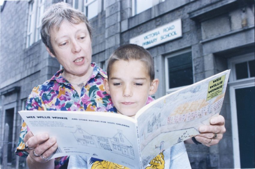1996: Lorna Glen, head teacher at Victoria Road School, Torry, reads a new book of nursery rhymes which was illustrated by her pupils. She is joined by William Kirton, 8, who has a picture in the book.