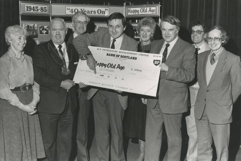 1985: As Buff Hardie of Scotland the What? points out, it's another £1000 for the Happy Old Age Appeal of the Voluntary Service Aberdeen. And helping hold up the big donation from BP are (left) Lord Provost Henry Rae and BP acting assistant  general manager (administration) Mr David Jamieson. Also pictured at the presentation at the VSA's annual meeting yesterday are Mrs Jean Drey, VSA chairman Mr Colin Murray, BP's Sheila Black, appeals assistant Mr John Thwaites and Aberdeen Old People's Welfare Council secretary Mr Bill Howie.