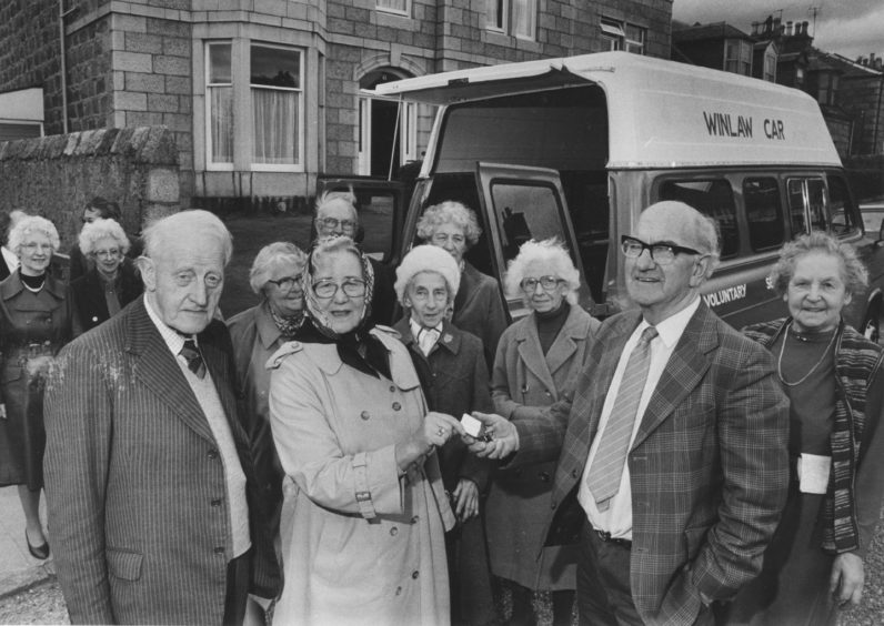1985: A new Transit ambulance is presented to Voluntary Service Aberdeen yesterday. Half the cost was met by the Winlaw Trust, and in the picture trustees James Collie and Miss Mary Wishart hand over the keys to voluntary driver Doug Singer while residents and staff of Deemount House look on. VSA said the ambulance would be used to provide outings and trips for housebound people.