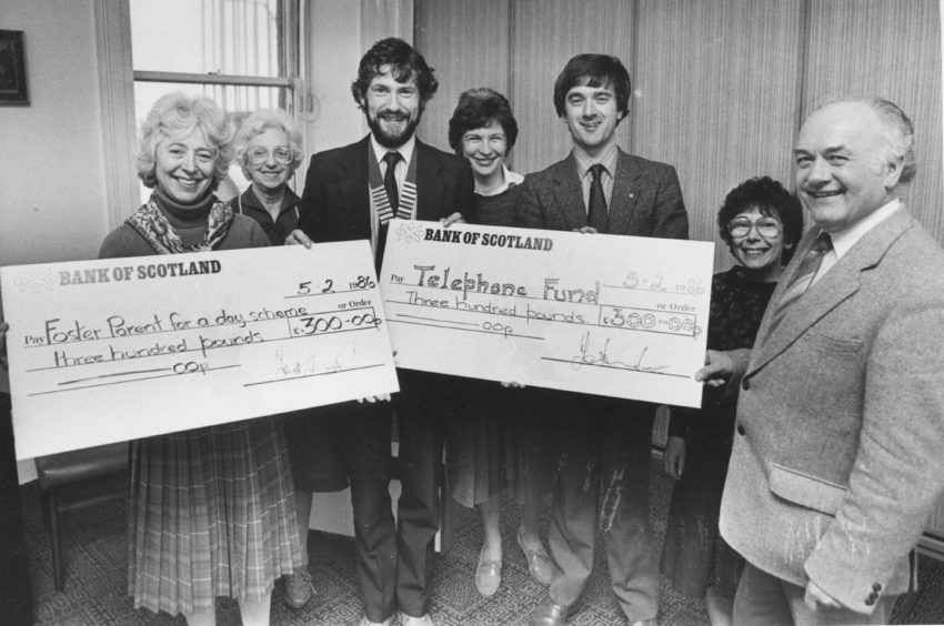 1986: Two cheques, each worth £300 were handed over to the Voluntary Service Aberdeen, yesterday. Centre left is Mr Quentin Tweedie, chairman of Aberdeen and Deeside Round Table, presenting a cheque to Mrs Jean Drey, VS publicity officer. The cash is to boost the Foster Parent for a Day scheme. Handing over the other cheque, towards the Telephone Fund for Housebound Old Folk, is table community service convener Mr Bill Slater (centre right). Accepting is senior social worker Mr Jim Mathieson. In the background are, from left, Ann Cowie, Margaret Brooker and Margaret Whyte.