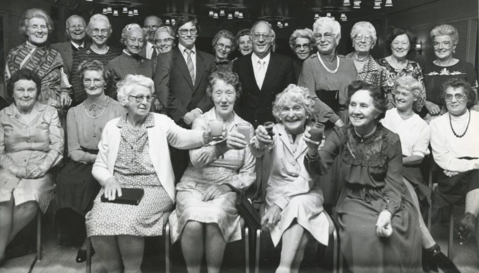 1986: Thrift pays. That was the message that came from the 21st birthday party to celebrate the coming of age of Voluntary Service Aberdeen, whose Thrift Shops in the city will next year have netted £1,000,000. Seated front are four of the original shop volunteers who worked in VS's first premises at 183 King Street. Left to right are: Mrs Jessie Sutherland, Mrs Gladys Thomson, Mrs Jean Cooper, and Mrs Lilian Morrison, all Aberdeen. Also pictured are Mr Brian Mennie, manager of the Gallowgate shop, and Mr Gordon Hardie, chairman of Voluntary Service, Aberdeen. The birthday party took the form of a buffet supper, held last night in the city's Station Hotel.