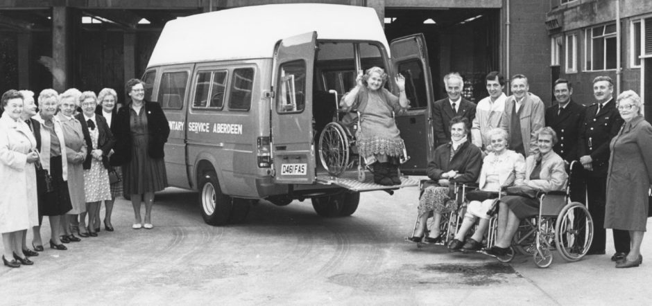 1987: Among the first to benefit from the windfall was Mrs Isabella Wiseman (83), in the new Christopher Car bought by VSA. On the right are members of the Grampian Fire Service, who drive the van, Sandy Corbett, Richard Kelbie, Eddie Rose, Archie Spence with organiser Mrs Margaret Grant and some of their customers. Some of the helpers are pictured on the left.