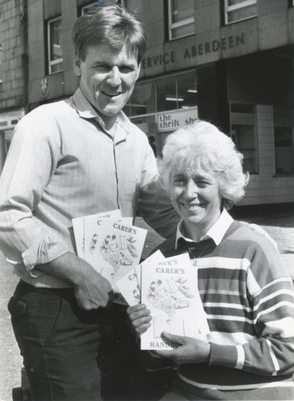 1989: Bert Lawrie, Development officer for the elderly and Jean Longley, publicity officer, with the Carer's Handbook.