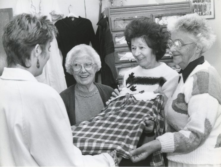 1991: Showing a customer a garment in the Castle Street Thrift Shop are, Mrs Gladys Reid , Mrs Joyce Clark and Mrs Madge Young.