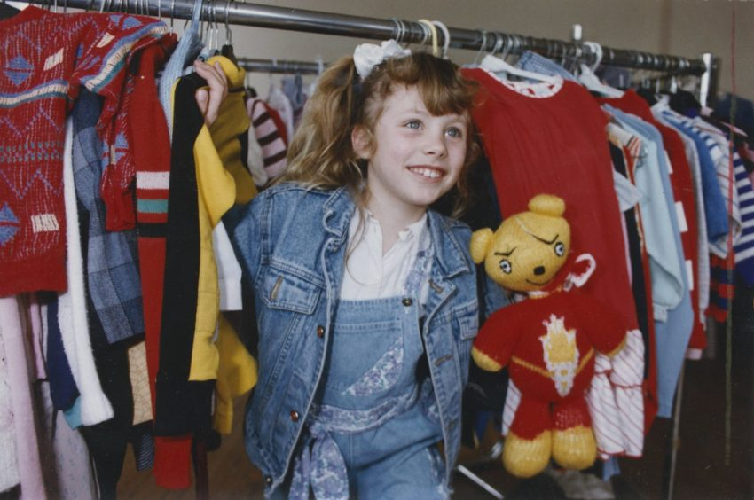 1992: Ashleigh Davies (7) helps Voluntary Service Aberdeen move their children's department.