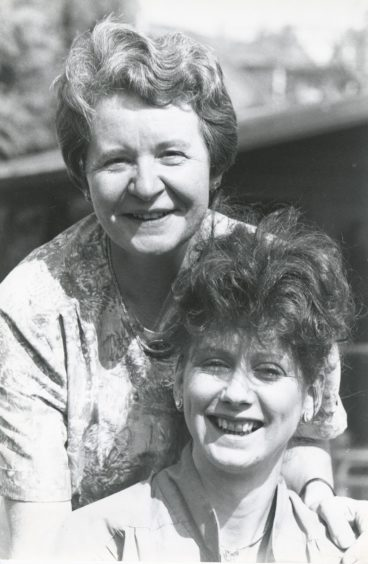 1992: It wasn't hard for Cynthia Beaton (left) and Dorothy Miles to volunteer smiles in the Aberdeen sunshine yesterday. Both work for Voluntary Service Aberdeen and both will receive their certificates in social services tomorrow at the Dundee campus of the Northern College.