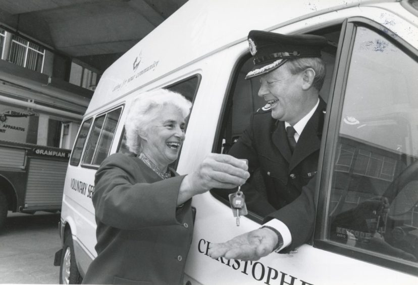1992: Voluntary Service Aberdeen chairwoman Doris Meston and Deputy Firemaster Sandy Lobban enjoy a joke at the handing over of keys to the new Christopher Car at North Anderson Drive fire station.
