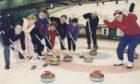 1995: Organiser Dennis Davidson roars on his rink from left, Stephen Birrell, Julie Fletcher, Ian Flett, Gwen Davidson, Jim Preacher, Chris Burns and Drew Leil.