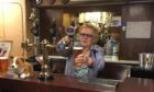 Agnes Flett, pouring a pint behind the bar of The Grill where she was a much-loved figure for 40 years.