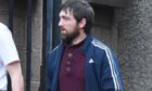 Alan Moir leaving court.