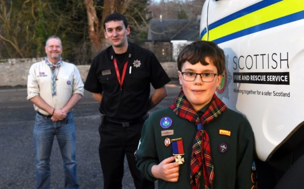 Dougie Simmers, Scouts regional commander for North East, Stewart Murray, watch commander and Cameron Barnes.