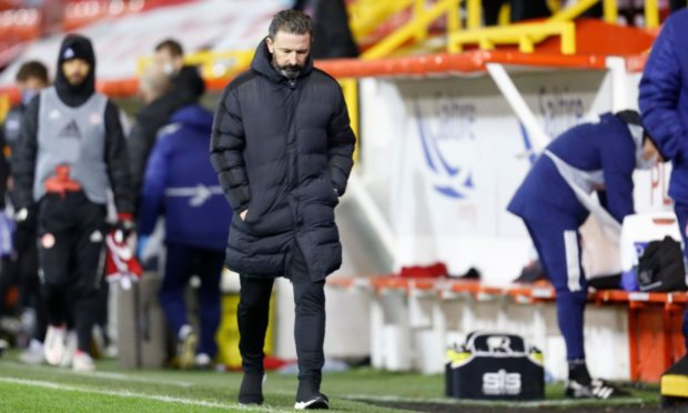 Aberdeen manager Derek McInnes looks dejected after the clash with Dundee United.