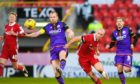 Dundee United Captain Mark Reynolds and Aberdeen's Curtis Main in action