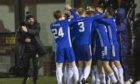 Cove Rangers players celebrate the winner from Ryan Strachan.